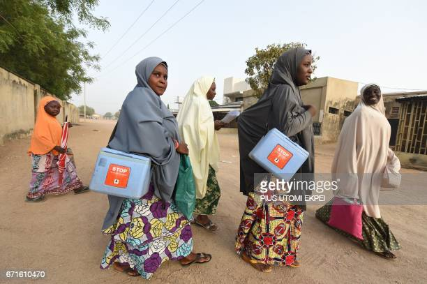 Health workers walk from house to house in search of children to immunise during vaccination campaign against polio at HotoroKudu Nassarawa district...