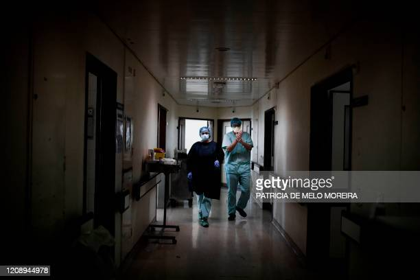 Health workers walk in the area reserved for COVID19 patients at the Santa Maria Hospital in Lisbon on April 2 2020 Over 500 people have died in...