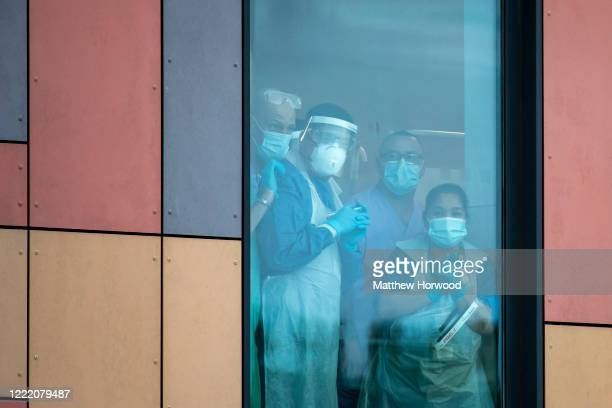 Health workers wearing PPE look out from a hospital window at the Royal Gwent Hospital on April 30 2020 in Newport Wales Following the success of the...