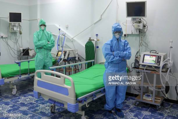 Health workers, wearing their personal protective equipment , are seen at the newly-inaugurated intensive care unit for COVID-19 patients in Yemen's...