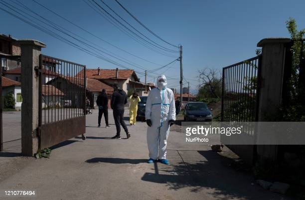 A health working wearing a hazmat suit near a testing site for COVID19 in the Roma neighborhood of Fakulteta in Sofia Bulgaria on April 23 2020...