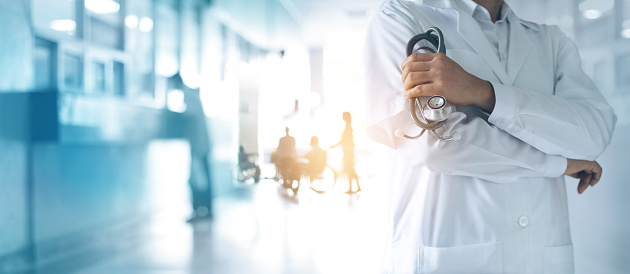 Healthcare and medical concept. Medicine doctor with stethoscope in hand and Patients come to the hospital background. 1023224308