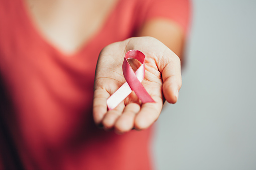 Healthcare and medicine concept - woman holding pink breast cancer awareness ribbon 1170403890