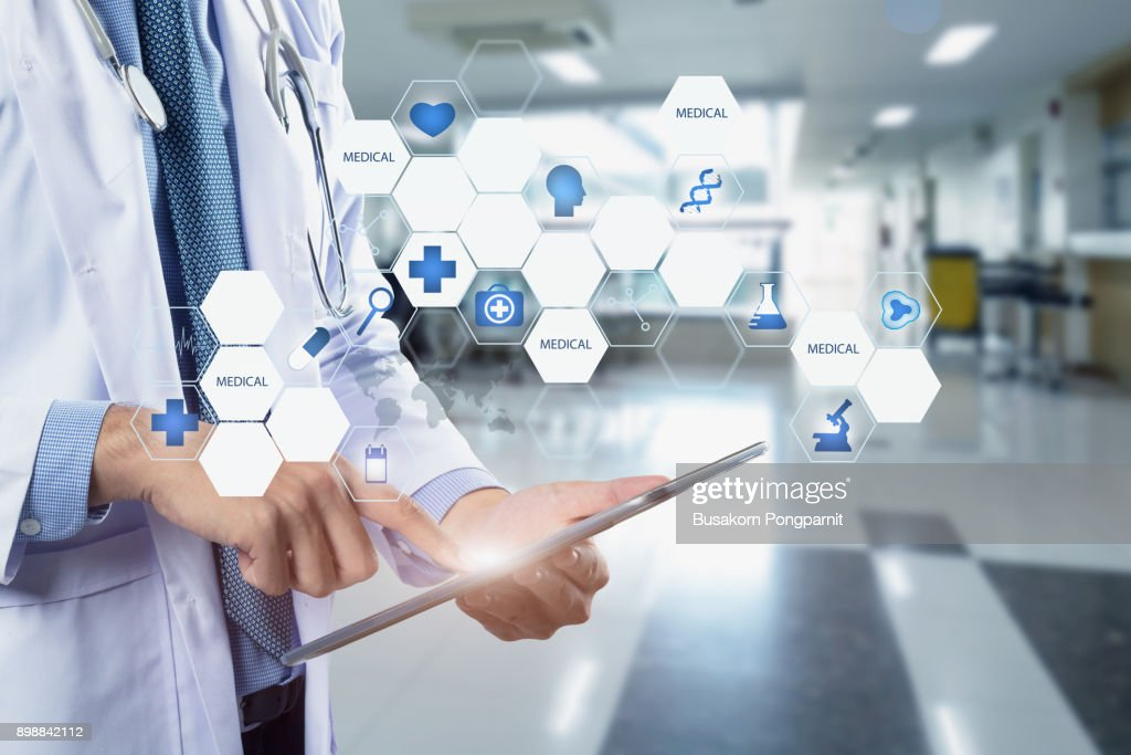 Healthcare And Medicine Doctor Using A Digital Tablet