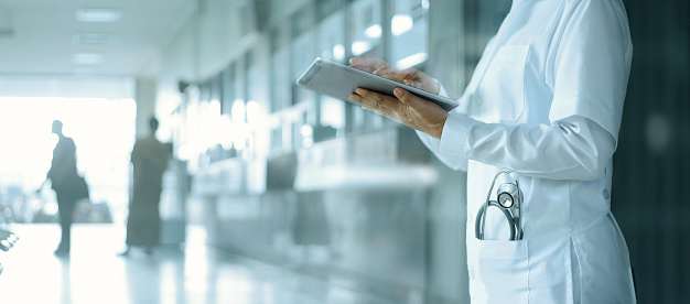 Healthcare and medicine. Medical and technology. Doctor working on digital tablet on hospital background 1182619274
