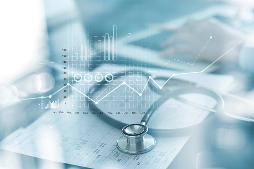Healthcare business graph and Medical examination and businessman analyzing data and growth chart on blured background 1165046681