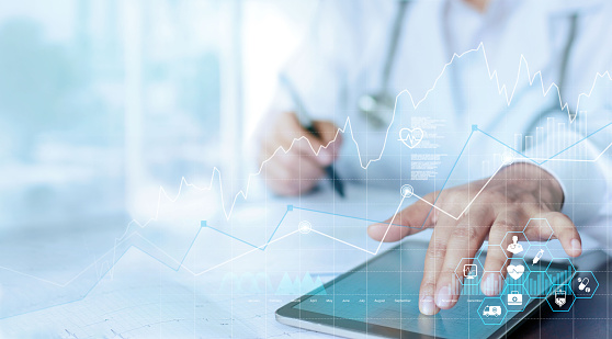 Healthcare business graph data and growth, Medical examination and doctor analyzing medical report network connection on tablet screen. 1185375169