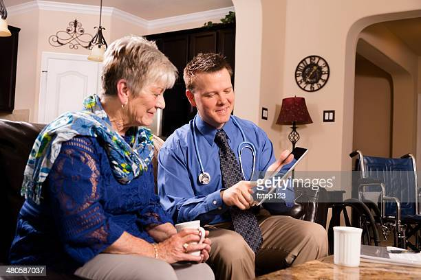 healthcare: concierge doctor visits senior woman at home. - house call stock pictures, royalty-free photos & images