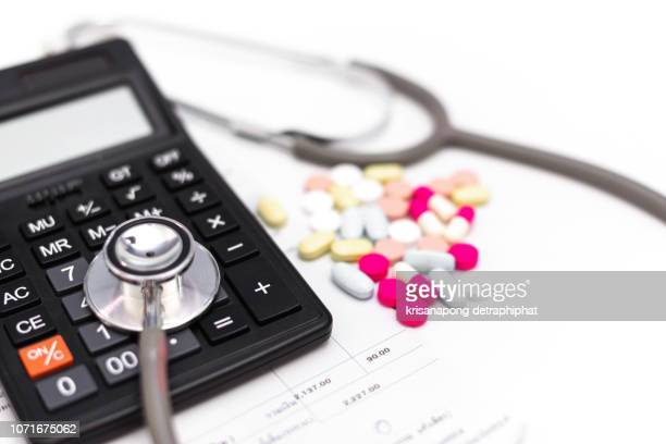 healthcare costs and fees concept.hand of smart doctor used a calculator for medical costs in modern hospital,medical - 改革 ストックフォトと画像