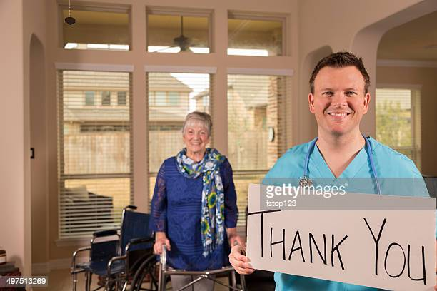 Healthcare: Doctor, senior patient at nursing home. 'Thank you' sign.