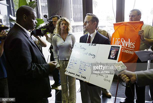 Healthcare Foundation President Michael Weinstein asks a security guard if he can present an oversized letter to pornography executive Larry Flynt as...