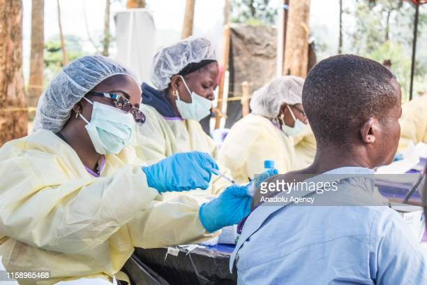 A healthcare member inoculates a man for Ebola suspicion to take precautions against the disease in Butembo Democratic Republic of the Congo on July...