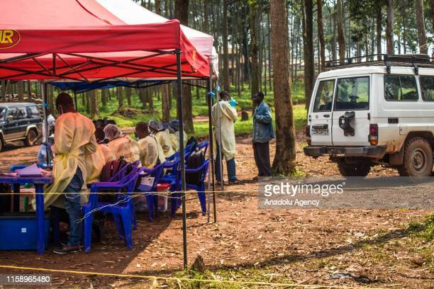 Healthcare members inoculate people for Ebola suspicion to take precautions against the disease in Butembo Democratic Republic of the Congo on July...