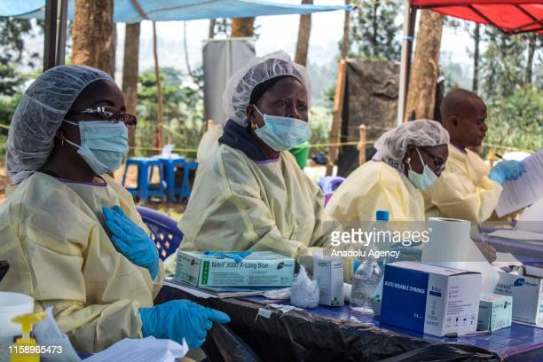 Healthcare members prepare to inoculate people for Ebola suspicion to take precautions against the disease in Butembo Democratic Republic of the...