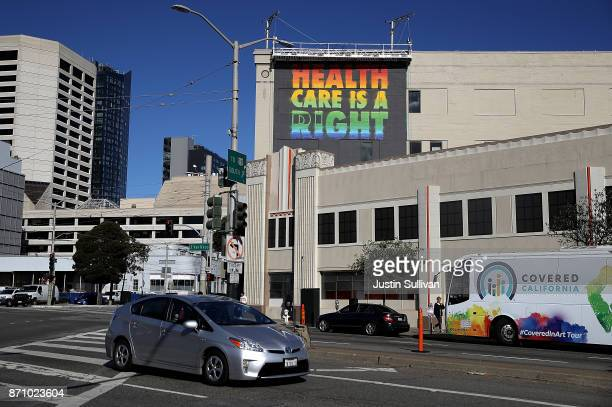 A healthcare mural by artist APEXER is displayed on the exterior of HealthRIGHT 360 on November 6 2017 in San Francisco California A statewide bus...