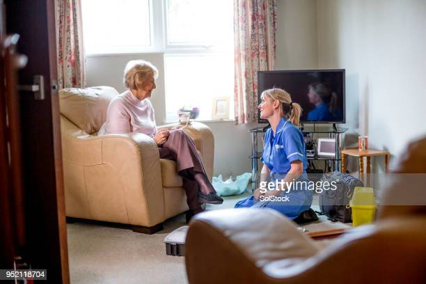 healthcare nurse on a house call - social services stock pictures, royalty-free photos & images