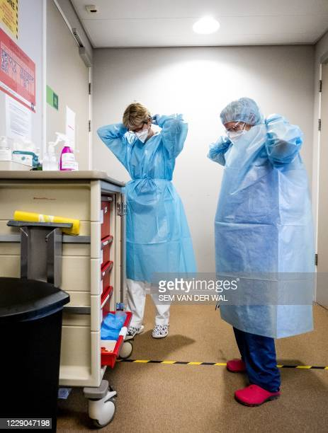 Healthcare personnel wear their protective equipments in the Aafje Zorghotel in Rotterdam on October 13 which has been made available again as a...
