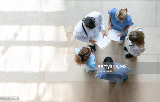 healthcare professionals during a meeting at the hospital - medical building stock pictures, royalty-free photos & images
