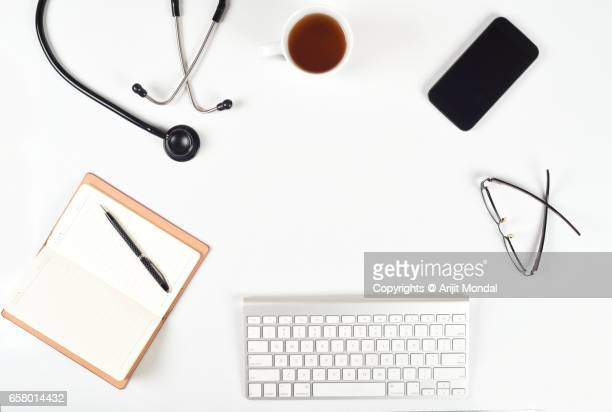 healthcare template for doctors and hospitals with stethoscope, smart phone directly above shot