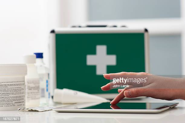 healthcare touchscreen - first aid kit stock pictures, royalty-free photos & images