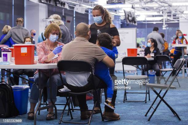 Healthcare worker administers a dose of the Johnson & Johnson Janssen Covid-19 Covid-19 vaccine at the Facebook Inc. Headquarters in Menlo Park,...