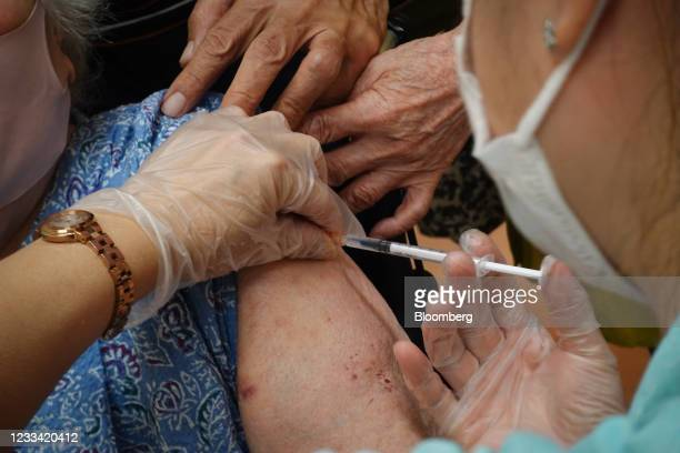 Healthcare worker administers the Pfizer-BioNTech Covid-19 vaccine at a vaccination site in Naha, Okinawa Prefecture, Japan, on Saturday, June 12,...