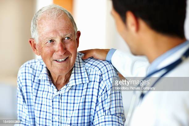 healthcare worker and elderly patient - male doctor stock photos and pictures