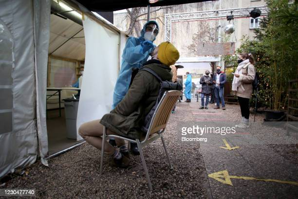 Healthcare worker conducts a Covid-19 test at the Kit Kat club which is functioning as a temporary coronavirus testing station in Berlin, Germany, on...