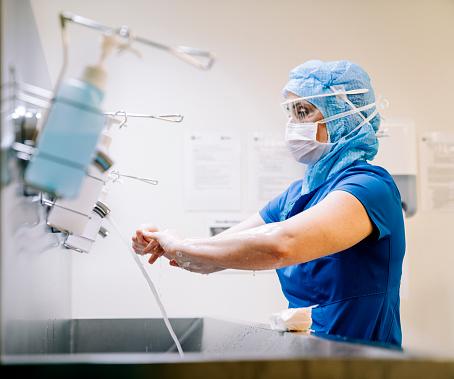 Healthcare worker doing sanitation of hands. 1210367212