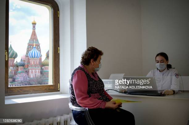 Healthcare worker gives a check-up to a woman before she received a dose of Russia's Sputnik V Covid-19 vaccine, at a vaccination centre in Moscow on...