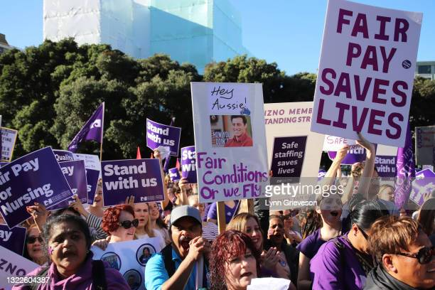 June 9: A Healthcare worker holds up a sign with a picture of actor Matt LeBlanc threatening to leave the country and migrate to Australia for better...