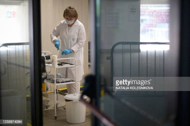 Healthcare worker prepares a dose of Russia's Sputnik Lite Covid-19 vaccine at a vaccination point for foreign people at the Luzhniki stadium in...