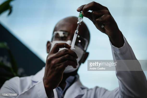 Healthcare worker prepares a dose of the Astrazeneca/Oxford vaccine before administer it to doctors at the Osvaldo Cruz Foundation on January 23,...