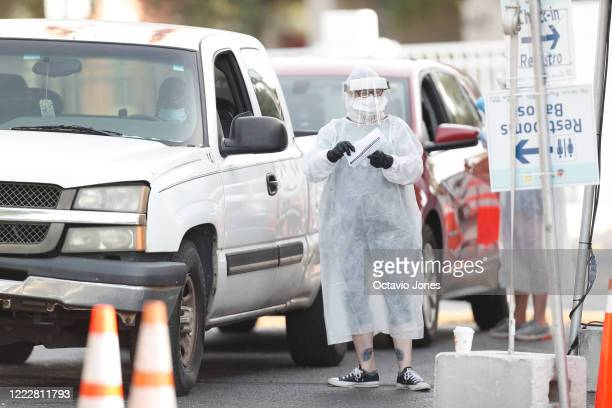 A healthcare worker prepares to administer a coronavirus test to a patient at the Lee Davis Community Resource Center on June 25 2020 in Tampa...