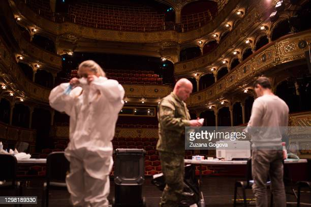 Healthcare worker put on new personal protective equipment after her team took a lunch break at the State Theatre Kosice on January 23, 2021 in...