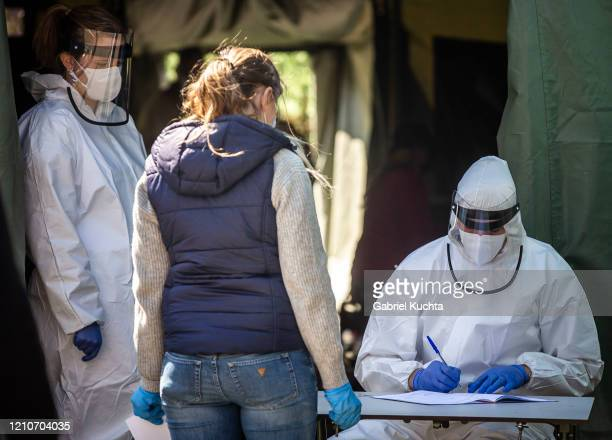 A healthcare worker registers people before getting tested for the coronavirus in Prague on April 23 2020 People have been forming long lines to get...