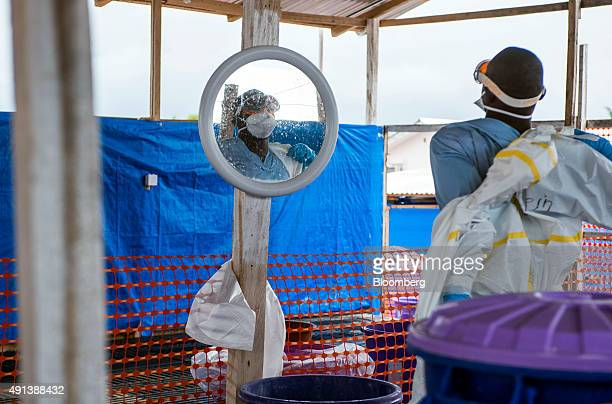 A healthcare worker removes his Personal Protective Equipment at an Ebola Treatment Center in Coyah Guinea on Thursday Sept 10 2015 An Ebola epidemic...