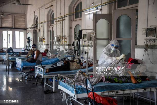 Healthcare worker Shama Shaikh cares for a patient who has Covid-19 in an ICU ward at the government-run St. George hospital on May 27, 2021 in...