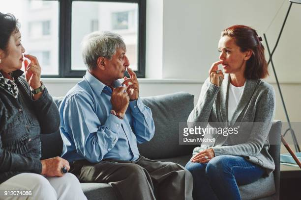 Healthcare worker showing the pressure points to senior couple