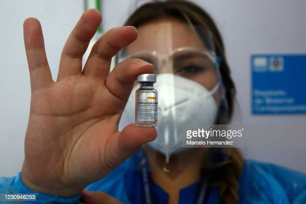 Healthcare worker shows a dose of the Sinovac Biotech Ltd vaccine during the first day of the mass vaccination campaign on February 3, 2021 in...