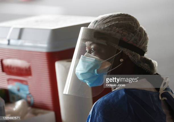 A healthcare worker wait for patients at the COVID19 drivethru testing site at the Duke Energy for the Arts Mahaffey Theater on July 8 2020 in St...