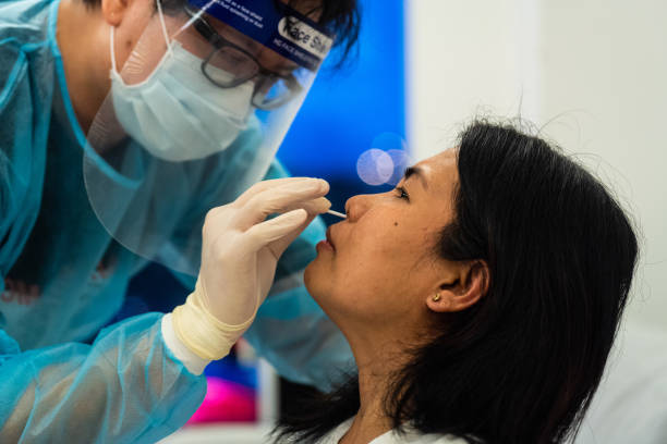 CHN: Covid-19 Swab Test as Hong Kong Sees Rise in Cases