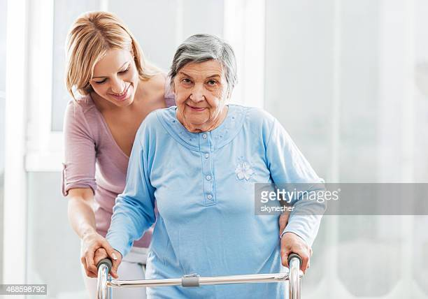 Healthcare worker with a senior patient.