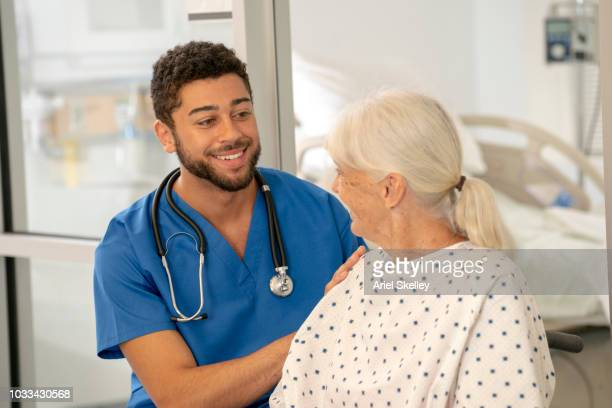 Healthcare Worker with Senior Patient in Hospital