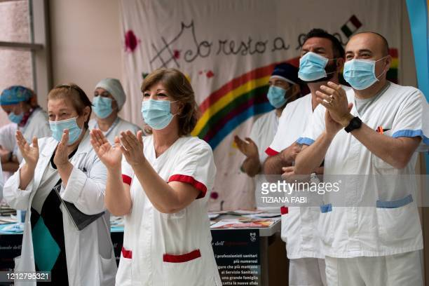 Healthcare workers applaud as they attend a performance by Italian violinist Fiamma Flavia Paolucci at Tor Vergata Hospital in Rome on May 12 as the...