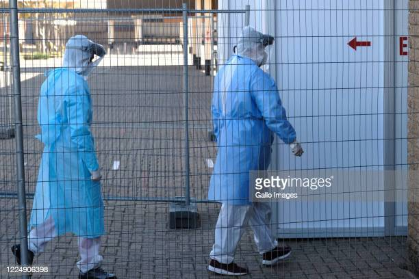 Healthcare workers enter a decontamination station at the Nasrec quarantine on July 03, 2020 in Johannesburg, South Africa. Gauteng MEC Dr Bandile...