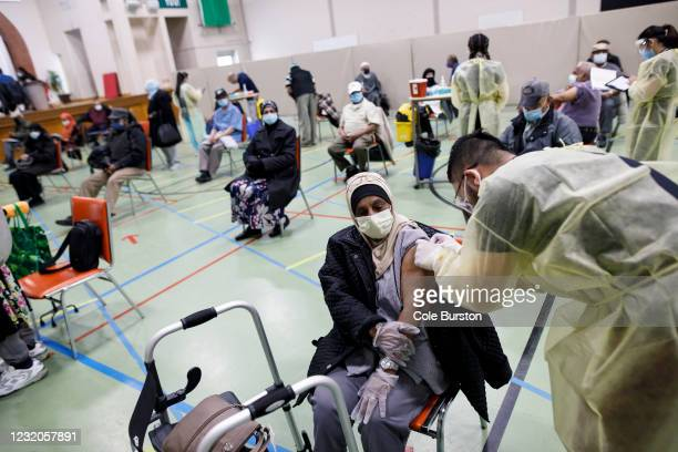 Healthcare workers from Humber River Hospital administer Moderna COVID-19 vaccinations to members of the Muslim community inside the Toronto and...
