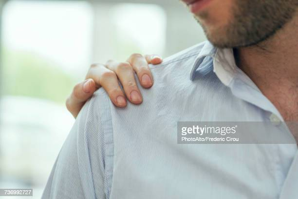 healthcare workers hand on patients shoulder - hand on shoulder stock pictures, royalty-free photos & images