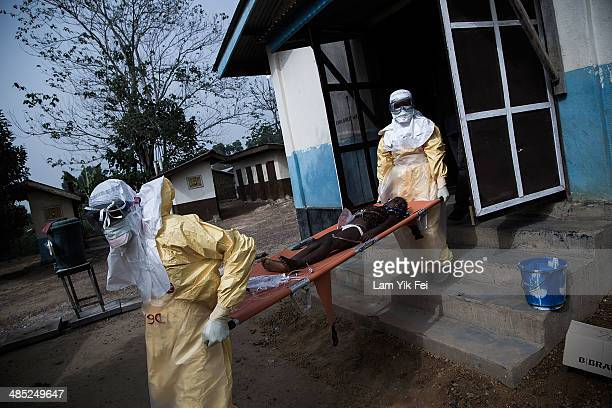 Healthcare workers in protective equipment transfer patient to Lassa isolation ward at Gondama Referral Centre on March 3 2014 in Bo district Sierra...