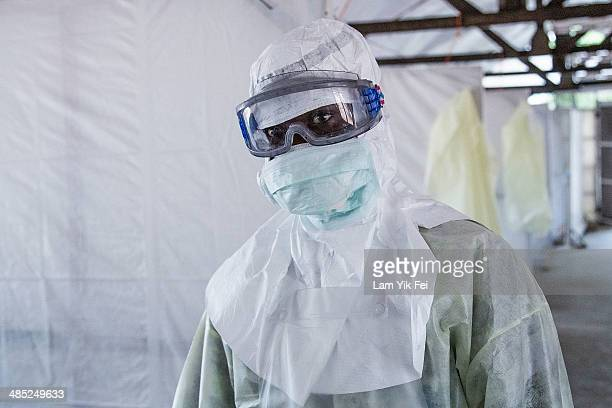 Healthcare workers in protective equipment work in Lassa isolation ward at Gondama Referral Centre on March 4 2014 in Bo district Sierra Leone In...